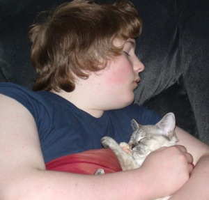My son and our kitten sleeping.